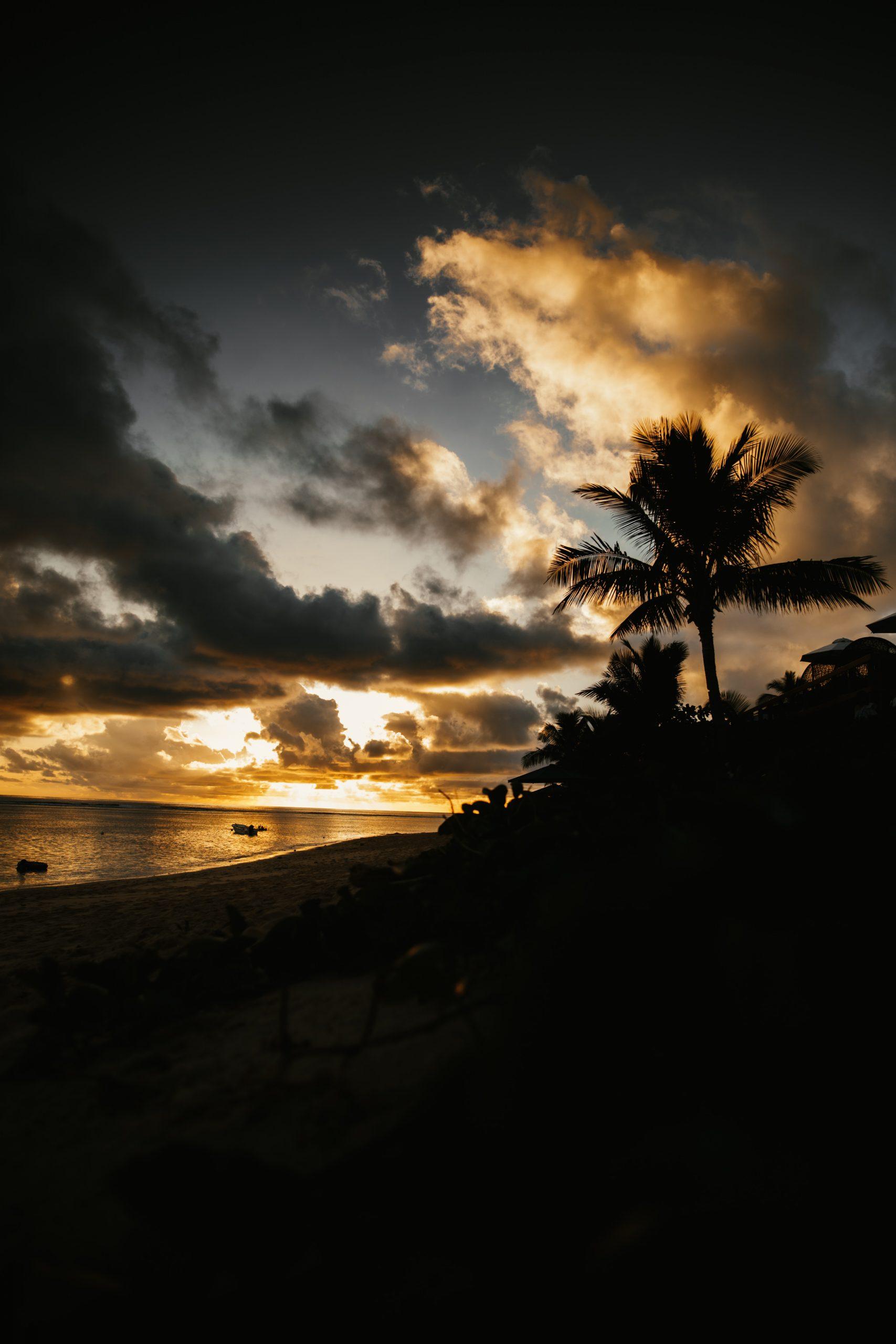 sunset over reef while on an island getaway in fiji