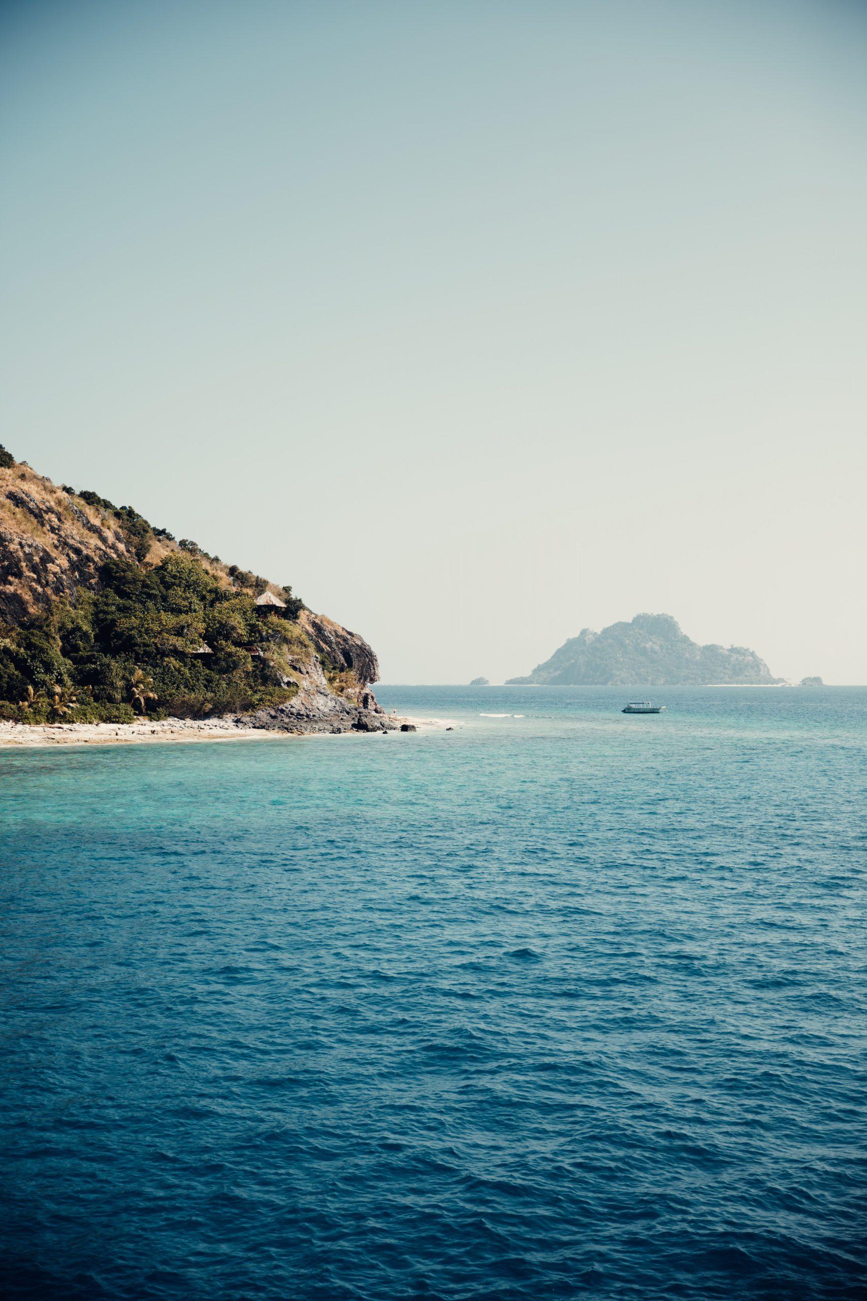 fiji islands, blue ocean water and surrounding reef